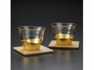A pair of teacups with coasters - gold leaf glassware